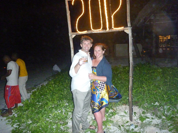 2012!: Courtney and Wade toast to 2012, below a sign on the beach
