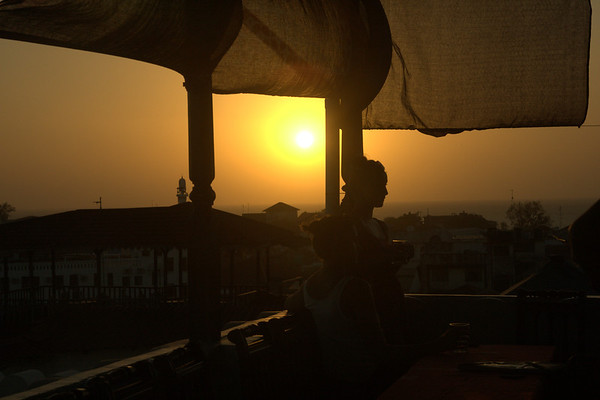 Enjoying the Sundowner: A customer enjoys her drink at the rooftop of 236 Hurumzi